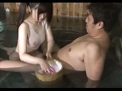 Oriental Girl In Swimsuit Giving Blowjob In The Bath