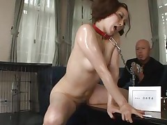 What a good kitty, but she still needs to be kept her in leash 'coz we don't want to let her run away don't we? She's horny and now we repay her with some milk, pouring it on the floor and letting her lick it like a bawdy cleft that she is. Maybe she wants to lick some cock and spunk too.