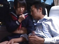 In that crowded bus everybody is tired and minds their own business but this schoolgirl is just shameless and wants some action. She sees the guy and how he takes out his dick and then looks at it for a while before putting that hard penis in her mouth. The cutie sucks him right there and everybody sees her