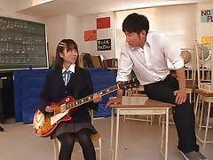 Pretty schoolgirl Asuka is in the classroom, learning to play the guitar. This bitch is more interested in her professor and this guy sees in her a lot of potential but not as a guitar player. She has a lot more talent when it's about a hard dick and gives him one hell of a hand job before bending over in front of him