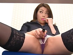Asian chick in nylons bows over for wicked fingering